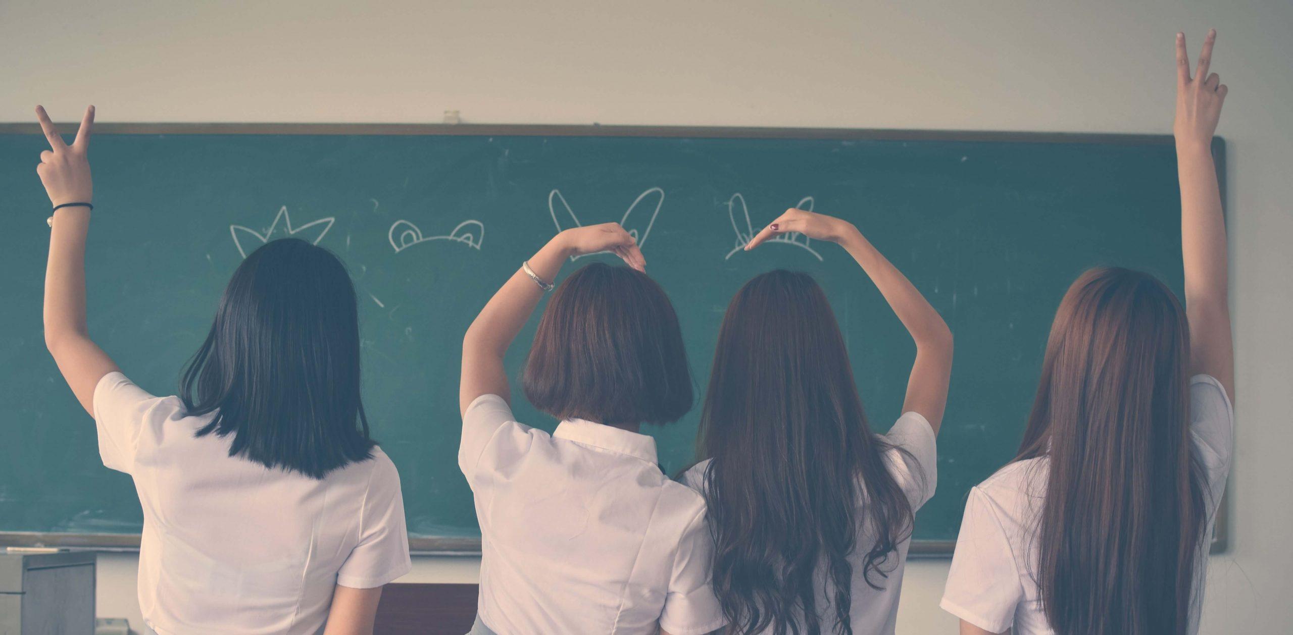 photo-of-four-girls-wearing-school-uniform-doing-hand-signs-710743 (1)